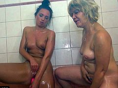 Take a look as this old blonde lesbo rubs soap all over her young lover in the shower. She slides a sex toy into the younger dyke's pussy to make her cum. The oldie has a sex toy of her own and loves to watch the cute babe masturbate.