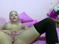 Do you enjoy watching busty ladies getting loose in bed? This slutty babe in the video has got a playful attitude and amazing tits that look like an open invitation to squeeze them wildly. Click to see the blonde-haired bitch fingering herself in front of the camera and then riding cock with passion!