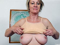 This dirty old Czech bitch shows off her saggy tits and pantyhose stockings. She licks her nipples and then leans back on the couch to spread open her legs and flash her old cooch. Her vagina is very inviting.