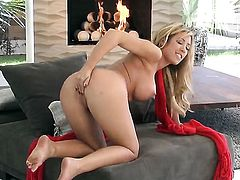 Capri Cavalli with big jugs and trimmed bush does striptease before she masturbates with desire