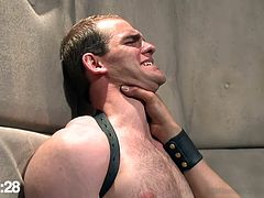 Tied with leather belts and ass whipped, our cute sex slave learns where his place is. the executor goes really rough on his ass, making it red and then grabs his neck and spanks his slutty face. All that bitch slaps and humiliation made our cheap gay whore hornier and ready for hard cock!