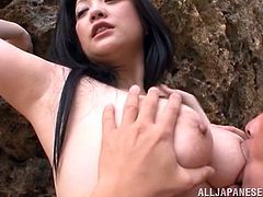Pretty Japanese bimbo with long hair stimulated as her big tits are sucked then gives a stunning titjob before getting hammered doggystyle