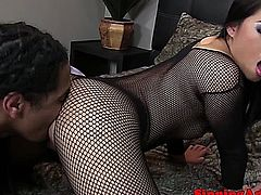 Beautiful asian babe in lingerie receives a rimjob from her black friend