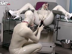 Fiona puts on a very kinky latex and lets her slave fuck her with a huge dildo.
