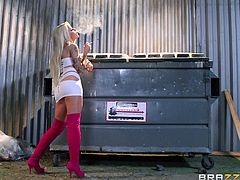 The blonde in the video is chatting with a friend, when a guy approaches her. Click to see Helly wearing pink high heeled boots and a crazy seductive outfit. The milf with big tits expresses her availability by moving her hips sensually. Enjoy watching Helly down on knees pleasing a big cock.