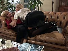 Hypnotized blonde lesbian in high heels unpins her miniskirt before enjoying her juicy pussy being licked and fingered immensely