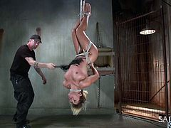 This dirty slut has been a bad slave, so her master is going to hang her upside down from the ceiling with rope. She sways back and forth upside down with rope around her ankles and neck. When she is allowed to come down she has to be tied to a rope so the master can spread her butt cheeks apart.