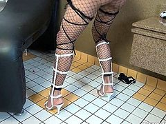 This hot looking transexual is all dolled up in fishnets and heels. She drops her panties down to her ankles and and flashes her tiny tits. She wraps her hand around her cock and beats off furiously with her giant cock pointed at the camera.