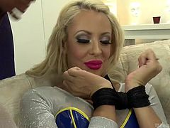 Courtney is a sexy blonde milf that is about to be dominated by a couple of sexy shemales. They bind her wrist together and take turns fucking her mouth with their big penises. Will she have to swallow shemale cum.
