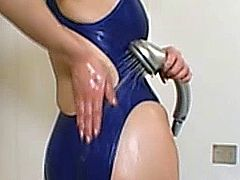 Japanese asian mature giving titfuck as she wears swimsuit