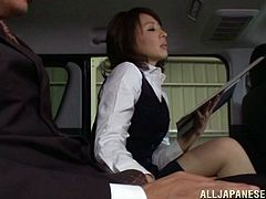 Captivating Asian dame gets cozy with her horny gentleman in the bus before awarding him a superb handjob in a reality shoot