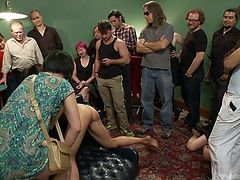 Seems that miss Vivi was a naughty bitch and all these people had enough with her. It's time to make her pay, so the people grabbed her violently, pinned her on that table, spread her legs and one guy stuffed his dick in her, while she got spanked on her thighs with a stick. Let's see what else they've did to her