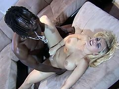 Vixenish blonde with long hair and big tits blowing a big cock before getting hammered hardcore in a steamy interracial action