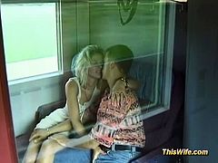 This blonde wife and her husband are exhibitionists. They touch each other before getting on the train and they also fuck as soon as they get in the train's toilet.