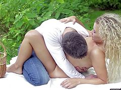 this couple are outside enjoying nature in the park. They are having a picnic together, but soon things get erotic. They undress and he licks on her nipples. He eats out her wet cunt and she sucks on his big, fat cock.