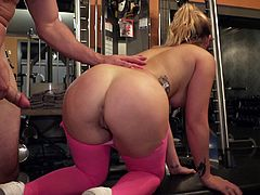 Tattooed Jenna Ashley enjoys jumping on a prick in a gym