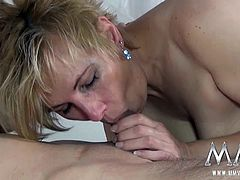 Busty blonde gets fucked hard by two horny studs.