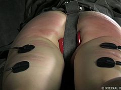 Tied up brunette gets her butt spanked without mercy