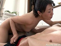 Astounding Japanese cougar stimulated as her natural tits are sucked then yells as she gets fingered before being throbbed doggystyle