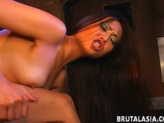 Stunning Japanese cutie takes a hard cock up her booty from behind. She munches on her lover's thick boner before taking a kinky ride on it.