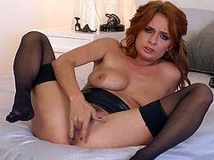Red haired gorgeous MILF in stockings tickles her kitty greedily