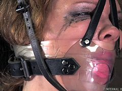 Tied up tattooed bitch with sexy tattoos gets her pussy punished