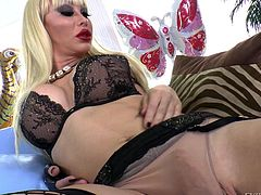 This transsexual beauty looks amazing with her massive breasts bursting out of her lingerie. She poses by the mirror and plays with her gigantic pecker. Watch as she masturbates while wearing fishnet stockings.