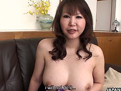 Stunning Japanese MILF with a pair of large knockers moans while her pussy is drilled hard. She sits down on her man's throbbing boner and rides on it passionately.