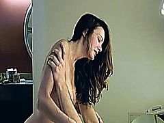 Oiled MILF takes dick in the ass
