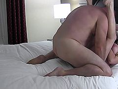 amateur mature couple film themselves in a hotelroom.