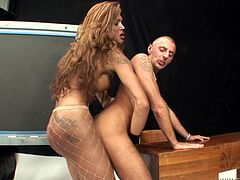 This sexy tan-skinned transsexual sows her man some pleasure by sucking on his hard cock. The sexy couple kisses as she rams her big black cock up his tight asshole. He beats off his cock and she fucks him hard from behind.