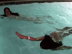 Pair brunettes have kinky in A pool