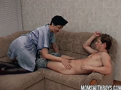 Checkout this horny stepmom caught this young boy masturbating on the couch.See how this mom teaches him lesson with her big tits and lusty pussy.Enjoy this hot fuck scene.