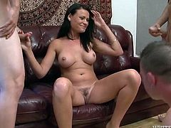 Sweet looking brunette milf serves two horny guys