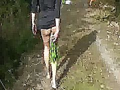 Extreme amateur wife parades round a forest with a huge vegetable jammed in her gaping asshole