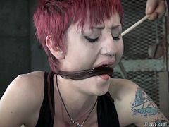 Horny tattooed red haired whore in stockings gets her anus hooked