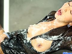 Marcia Hase is a classy Asian chick. She gets a shower of cum from a cock that appears trough a glory hole. She is literally covered in thick, sticky sperm.