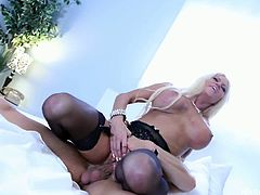 Nikita Von James hooks up with a guy named Nick and have a wild fuck in bed. She looks amazingly hot in black lingerie when she takes cock and sperm in her mouth.
