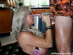 Wifey is a smoking hot blonde milf with huge knockers. She invites the gardener indoors to cool down, but things get even hotter when she takes his cock in her pussy and his cum in her mouth.