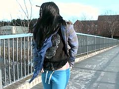 This dirty bitch is out in the cold outside, with her pants around her ankles. Lucia is leaning against the building and playing with her pussy, when she is caught in the act! She is embarrassed, but she takes a walk with the men, who caught her and then, flicks her clit some more in public.