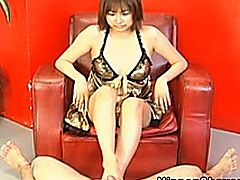 Shaved asian babe in sexy lingerie giving some dude a footjob