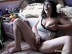 I had a hidden camera placed in her room and caught her playing with her hairy pussy.