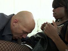 This black beauty has a need for cock and spunk. She makes out with her man and he turns her on so much. He makes her even hornier, by sucking on her big tranny cock! She guides his bald head down, onto her thick shaft. Finally, she undoes his pants and gives him a nice blowjob. Will she swallow his sperm?