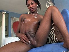 This ebony transsexual has a very massive dick, and she loves it when people watch her jerking. She looks super cute in her black tank top and white shorts. She pulls them down and whips her stiff cock to beat off for you. Will you see her cum?