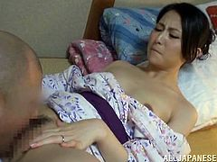 This sexy milf wants, to make her husband feel good. She is dressed up in nice geisha outfit and she lets him lick her perky nipples. They tongue kiss each other and he fingers her sweet, warm cunt. Look at how he eats her out, with such care.