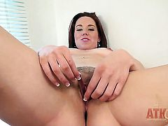 Brunette Lizzie Tucker gets the pleasure from pussy rubbing