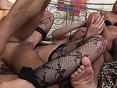 Horny blonde MILFs, Joana and Ulrika, both wearing fishnet stockings, get it on with a couple of well hung men, indulging their foot fetish, as well as getting their shaved pussies thoroughly fucked in this hot group sex session.