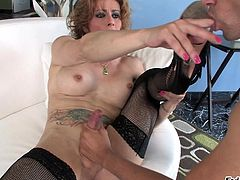 Mature shemale gets ass licked and cock banged before taking cumshot in her mouth and gets her toes licked in fishnet by stud