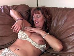 Milf redhead in lace lingerie plays with her tits