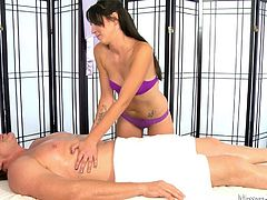 When you come into this massage parlour, you will feel so relaxed and warm. This guy lays back on the table and the lovely brunette rubs her hands all over him. Will the sexy babe give him a happy ending?